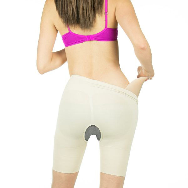 Rear view crossdressing crotchless garment with hip pad