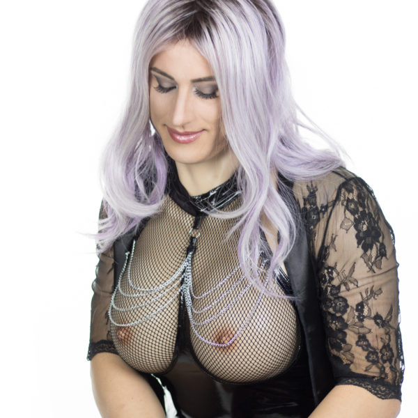 Crossdresser Diana Vandenburg in purple wig wearing drag queen silicone breast plate